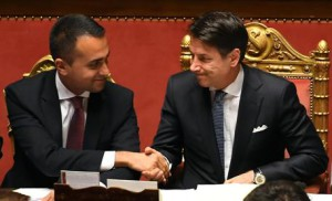 Italian premier Giuseppe Conte (R) shakes hands with Foreign affairs minister Luigi di Maio, ahead of a confidence vote, in Rome, Italy, 10 September 2019.Conte's new government on the day faced the second of two confidence votes in parliament -- in the Senate, after passing the first one in the Lower House a day earlier. His new government is a coalition between the anti-establishment 5-Star Movement (M5S) and the center-left Democratic Party (PD). ANSA/MAURIZIO BRAMBATTI